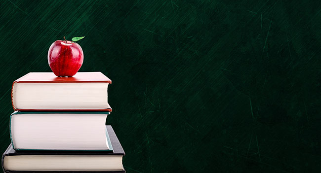 Education Concept With Apple On Books And Chalkboard Background